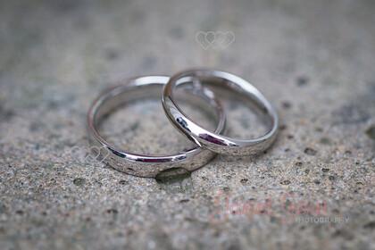 Wedding-Rings-0005   Wedding rings on stone ledge   Keywords: wedding rings stone bridal